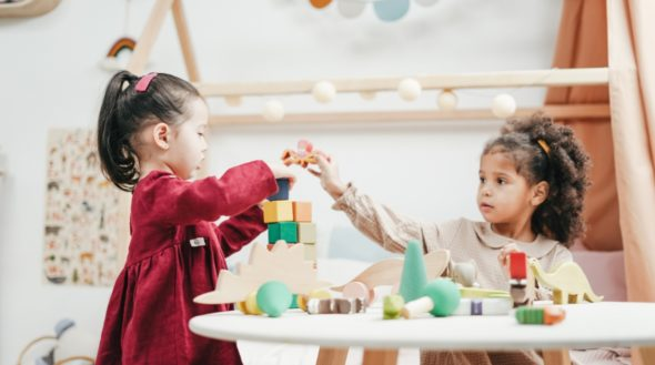 two girls playing with building blocks